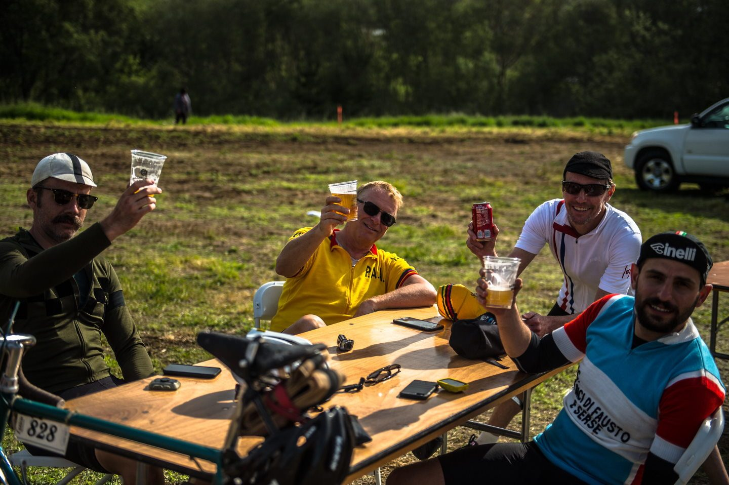 Eroica cyclists drinking beers